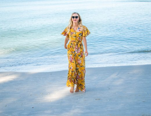 A floral faux wrap maxi dress with flutter sleeves in a deep mustard color
